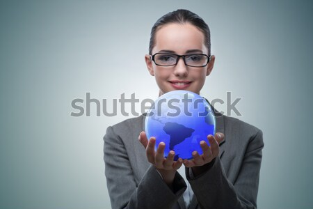 Stock photo: The woman holding crystall ball isolated on white