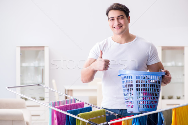 The man doing laundry at home Stock photo © Elnur