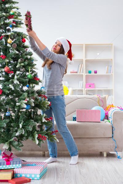 The single girl decorating christmas tree Stock photo © Elnur