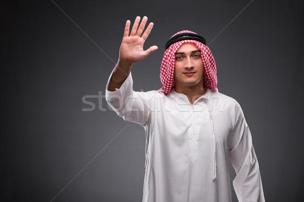 Arab businessman on gray background Stock photo © Elnur