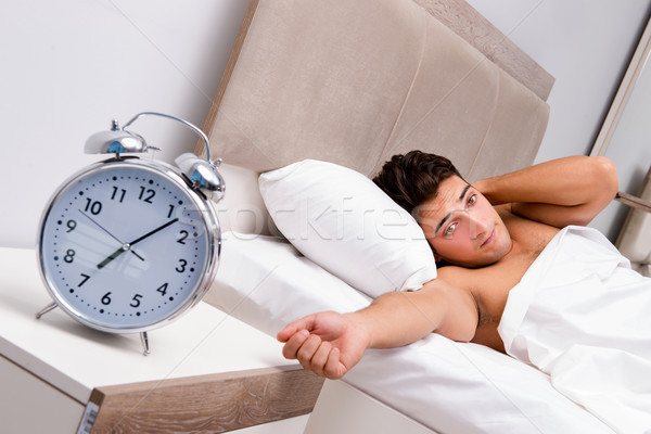 Man having trouble waking up in morning Stock photo © Elnur