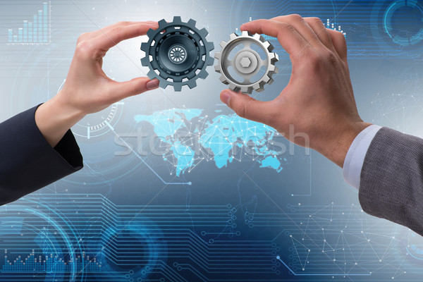 Businessman in teamwork concept with cogwheels Stock photo © Elnur