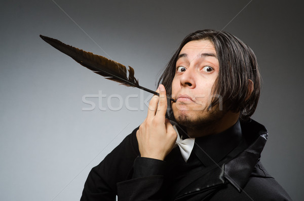 Young man with writing feather Stock photo © Elnur