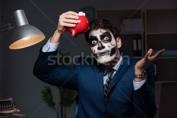 The businessman with scary face mask working late in office Stock photo © Elnur