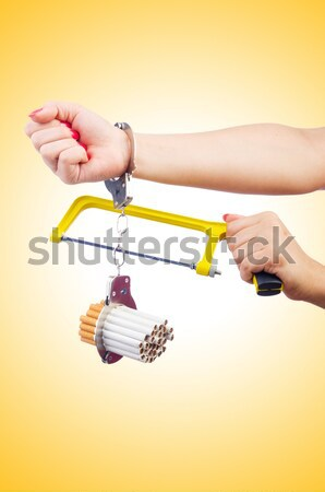 Addiction concept with cigarettes and handcuffs Stock photo © Elnur