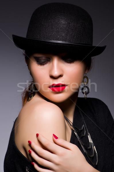 Woman in retro concept in dark room Stock photo © Elnur