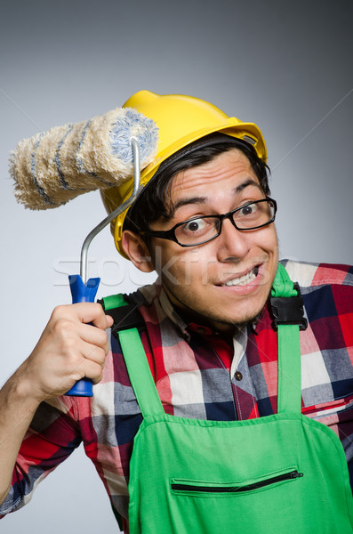 Stock photo: Funny painter with hardhat and roller