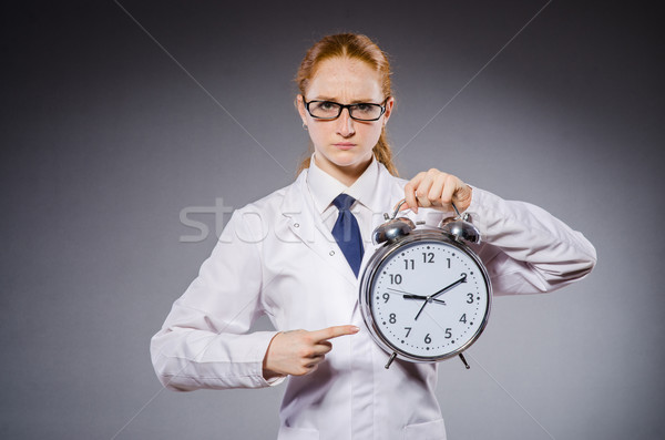 Woman doctor missing her deadlines Stock photo © Elnur