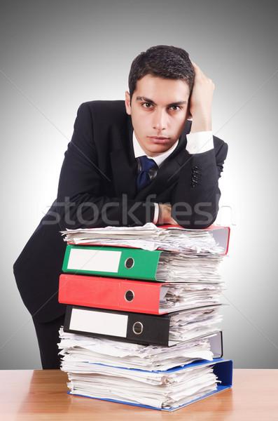 молодые занят бизнесмен столе служба телефон Сток-фото © Elnur