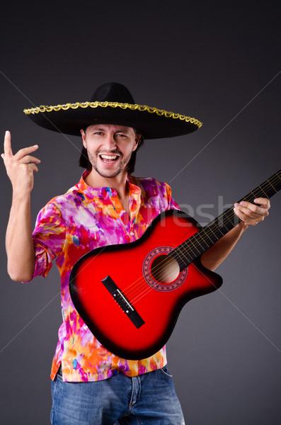 Man wearing sombrero with guitar Stock photo © Elnur