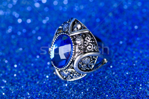 Jewellery ring against blue background Stock photo © Elnur