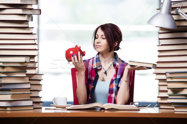 Concept of expensive textbooks with female student Stock photo © Elnur