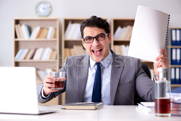 Young businessman drinking from stress Stock photo © Elnur