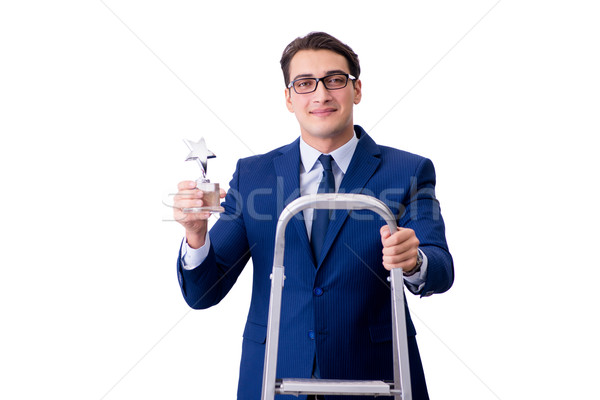 Businessman at top of ladder with star prize Stock photo © Elnur