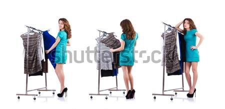 Nude man choosing clothing isolated on white Stock photo © Elnur