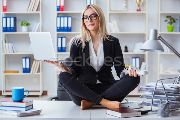 Businesswoman frustrated meditating in the office Stock photo © Elnur