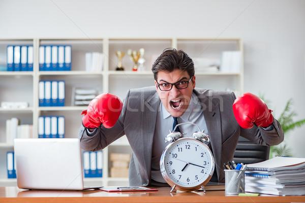 Enojado empresario guantes de boxeo trabajo cuaderno Foto stock © Elnur