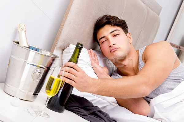 Man with hangover after late partying Stock photo © Elnur