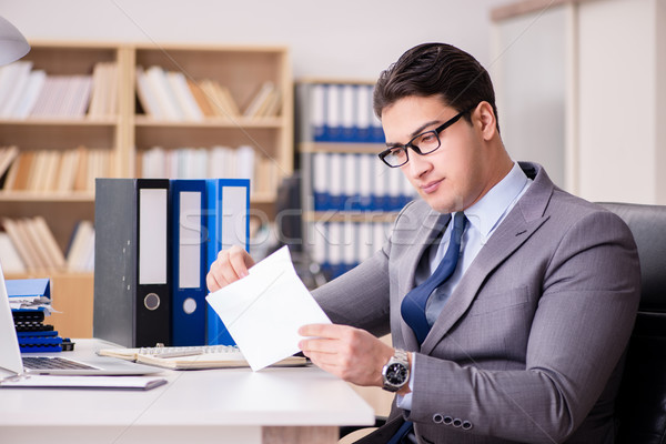Businessman receiving letter in the office Stock photo © Elnur