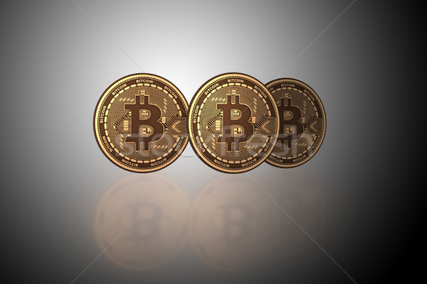 Bitcoins in cryptocurrency blockchain concept - 3d rendering Stock photo © Elnur