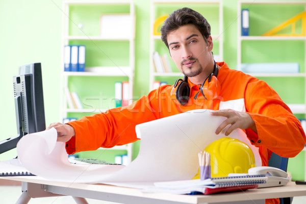 Construction supervisor planning new project in office Stock photo © Elnur