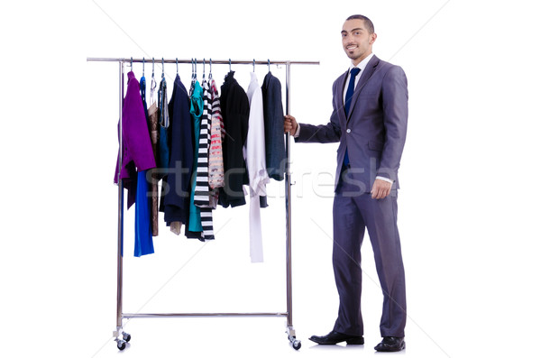 Stock photo: Businessman with rack of clothing