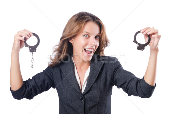 Female businesswoman with handcuffs on white Stock photo © Elnur