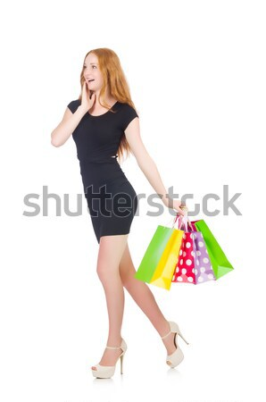 Woman after shopping spree on white Stock photo © Elnur