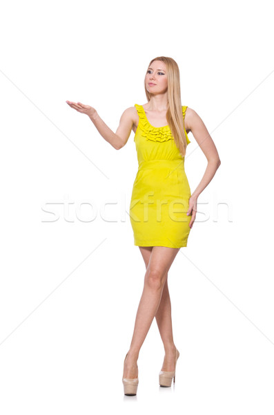 Pretty tall woman in short yellow dress isolated on white Stock photo © Elnur