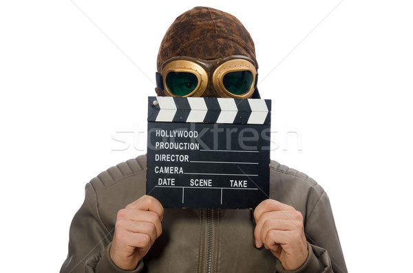 Pilot holding movie clapboard on white Stock photo © Elnur