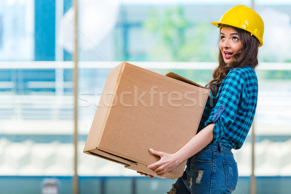 Nice young woman carrying box Stock photo © Elnur