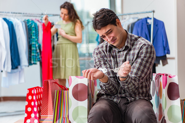 Man fed up with wife shopping in shop Stock photo © Elnur
