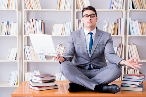 Businessman student in lotus position meditating with a laptop i Stock photo © Elnur