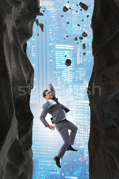 Stock photo: Businessman overcoming challenges in business concept