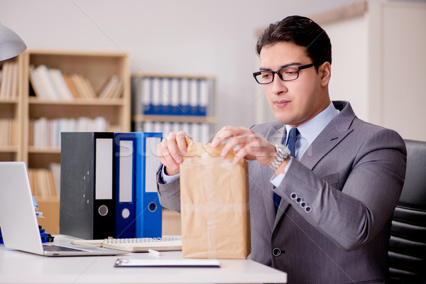 Businessman receiving parcel in office Stock photo © Elnur