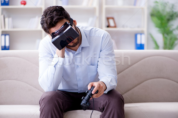 Student gamer playing games at home Stock photo © Elnur