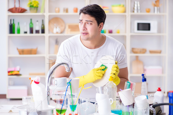Man frustrated at having to wash dishes Stock photo © Elnur