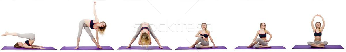 The young female doing exercises on white Stock photo © Elnur