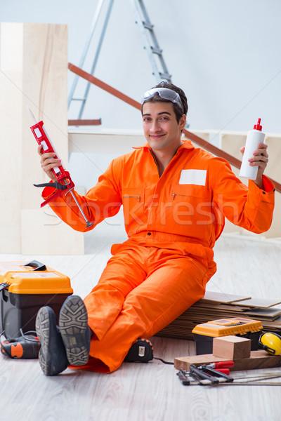 Beszállító dolgozik fapadló iroda férfi boldog Stock fotó © Elnur