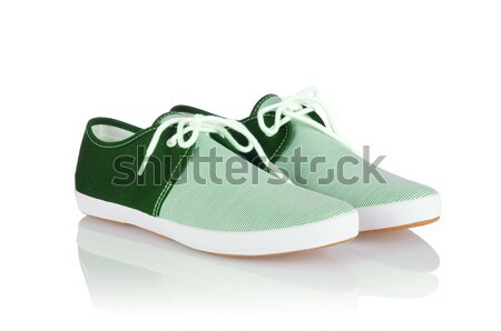 Sporty shoes in sport shoes concept on white Stock photo © Elnur