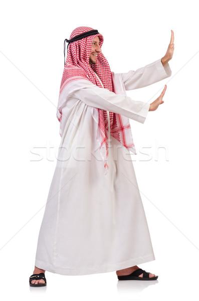 Arab man pushing away virtual obstacle isoalted on white Stock photo © Elnur