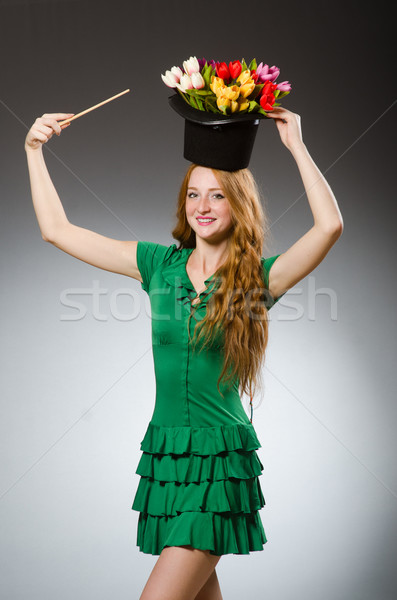 Woman magician wearing green dress Stock photo © Elnur