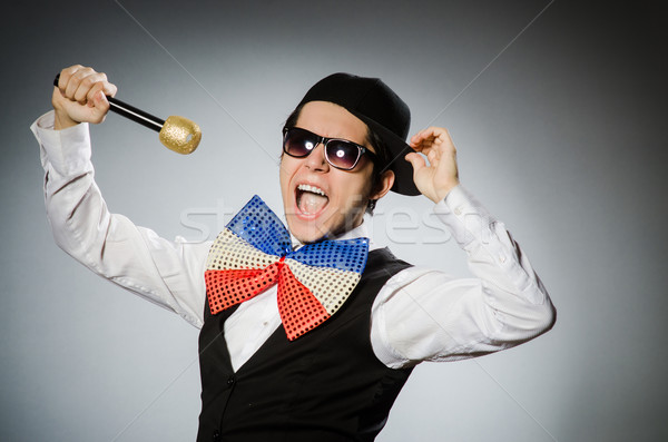 Funny man with mic in karaoke concept Stock photo © Elnur