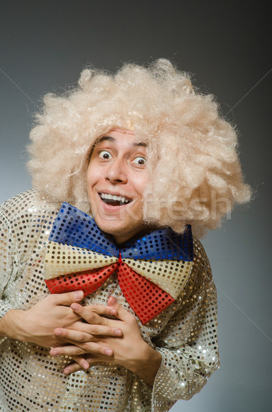 Funny man with afro wig Stock photo © Elnur