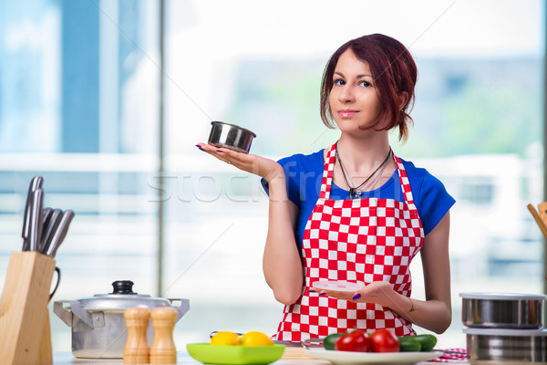 Young cook working in the kitchen Stock photo © Elnur