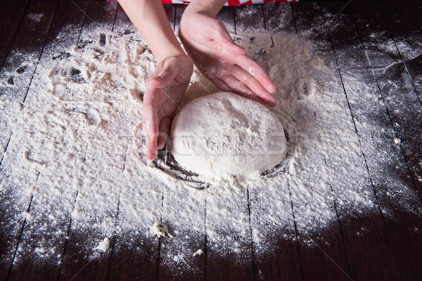 The cook preparing dough for baking in the kitchen Stock photo © Elnur