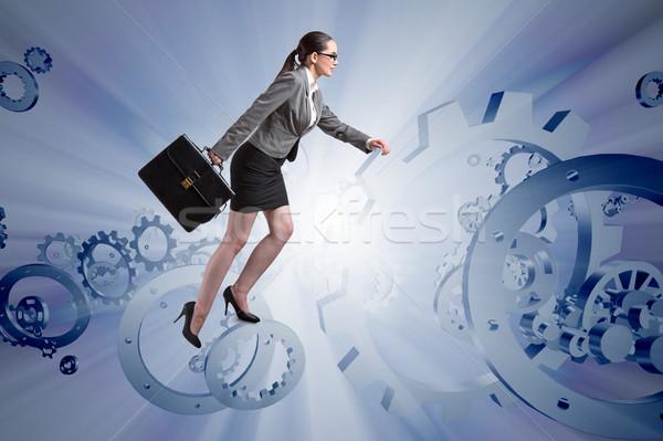 Woman businessman climbing cogwheels Stock photo © Elnur