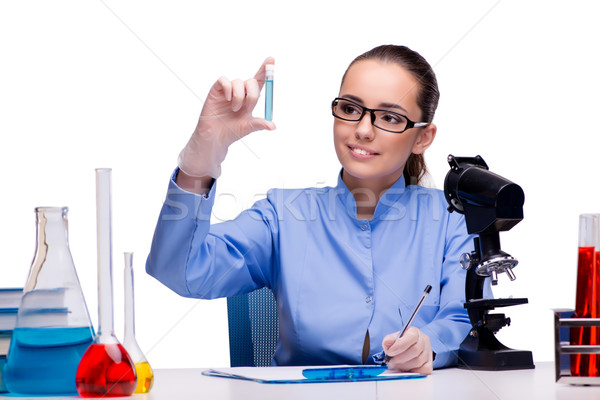 Lab chemist working with microscope and tubes Stock photo © Elnur
