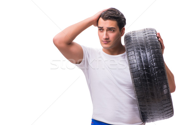 The handsome tyre repairman isolated on white Stock photo © Elnur