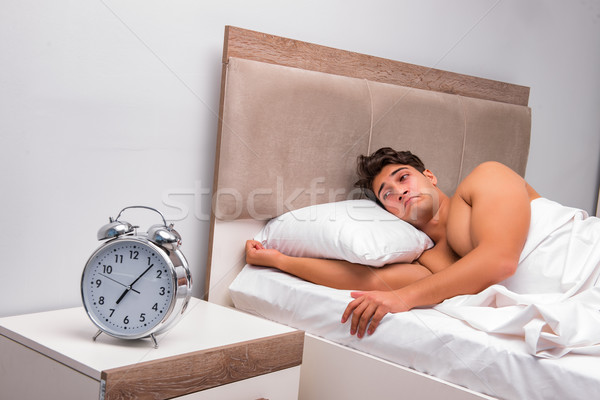 The man having trouble waking up in the morning Stock photo © Elnur